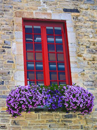 17th: Old window with flowers in a 17th century building