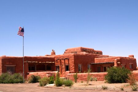 adobe pueblo: An abode style inn is located in the Arizona desert.