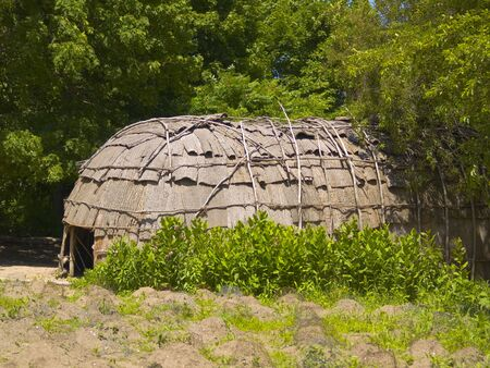 wampanoag: A Wampanoag Indian hut at Plimoth Plantation in Plymouth, MA. Stock Photo