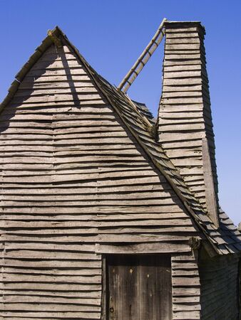 17th: Reproduction of a 17th century English hut with chimney at Plimoth Plantation, Massachusetts, USA