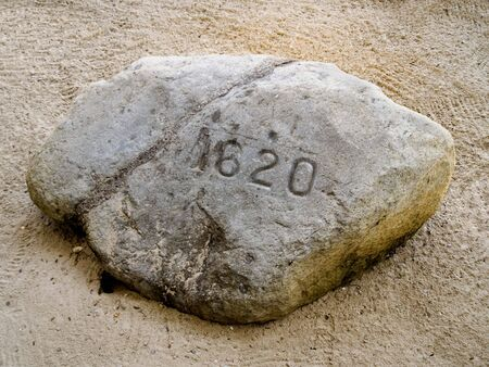 landed: Plymouth rock, where the Mayflower supposedly landed when it arrived in the New World. Stock Photo