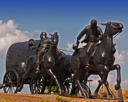 pioneers: Statue of pioneers who participated in the Oklahoma Land Rush. Stock Photo