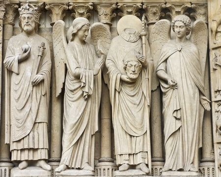 Statues of saints on facade of Notre Dame cathedral in Paris photo