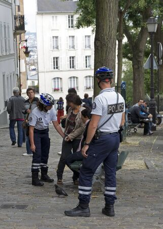 suspected: Paris, France - July 2011 - Two young Roma women are questioned and searched by French police after being suspected of theft in Montmartre. Recently, the French government has carcked down on some of the Roma population due to crimes involving theft and e