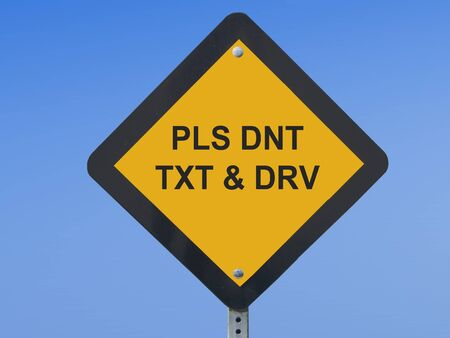 Traffic Sign Warning Against Texting While Driving photo