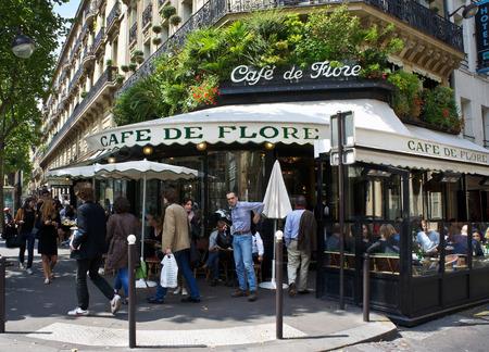 Paris Cafe - Paris, France - July 14, 2011 - Diners enjoy the sun at the famous Cafe de Flore in Paris  The cafe lifestyle draws millions of tourists to Paris each year