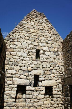 Closeup of a wall of a building at the Incan ruins of Machu Picchu, Peru 版權商用圖片