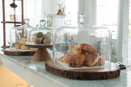 Bakery displayed in glass bell.