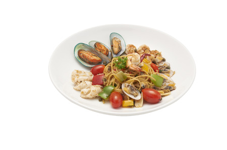 Seafood pasta Spaghetti with Clams, Prawns, Seafood Cocktail isolated on white background clipping path.