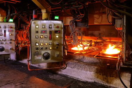 Processing in forming machine after steel-making furnace in smelting steel plant. Stock Photo