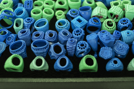 Mold for making ring jewelry.Green and blue mold from wax for ring industrial. tools for jewelry factory.