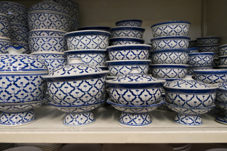 Plate and bowl vintage style in kitchenware shop. Pattern of blue and white in asia style.
