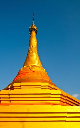 Golden pagoda in temple ,Thailand