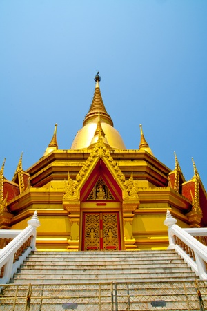 Golden pagoda in buddhist temple ,Thailand Stock Photo