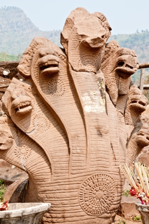 Heads of serpent,naga, at Castle of the pool ,Laos