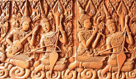 carving angle  are playing thai music , buddhist temple ,thailand photo