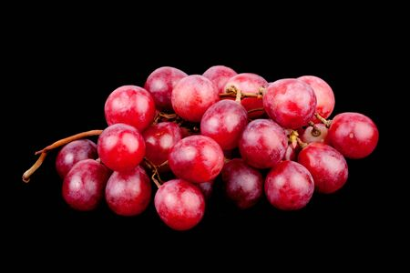 resh red grape on  black background