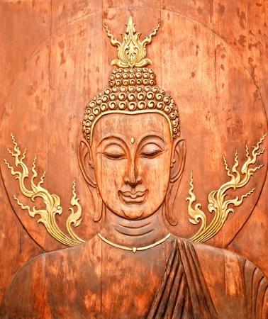 teak: Face of Buddha carved on teak