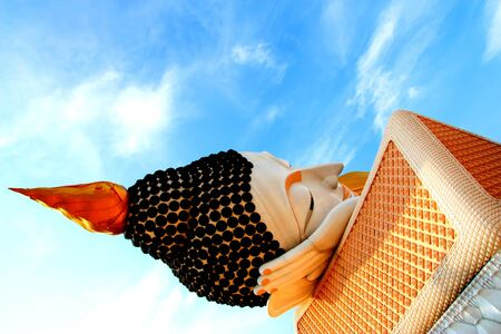 Reclining Buddha in buddhist temple Stock Photo