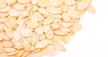 Raw white pumpkin seeds  on white background Stock Photo