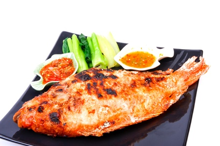 Grilled fish wite sauce on white photo