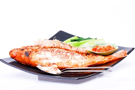 Grilled fish wite sauce on white Stock Photo - 17344132