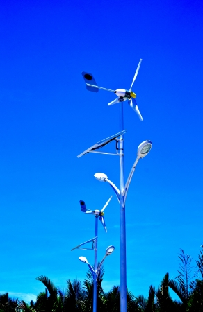 solar cell and windmill   with blue sky photo