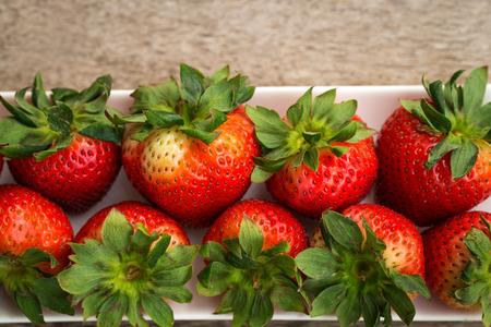 strawberrys: Strawberrys in long plate  on  plank wood