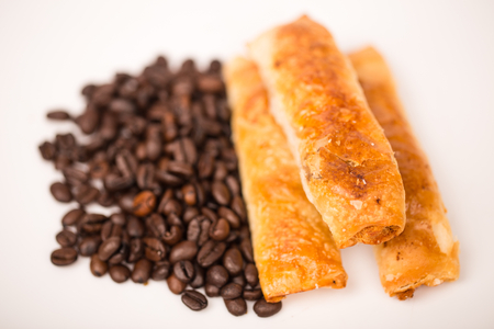 coffee bean and  spring roll on white