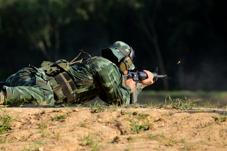 soldier is shooting rifle at goal