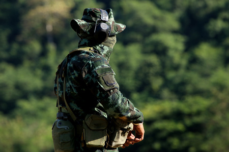 soldier who prepared for shoting rifle Stock Photo