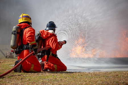 Firefighters are fighting fire with a  fire brigade