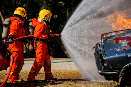 Firefighters are fighting fire with a  fire brigade 免版税图像 - 95022711