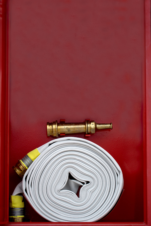 New fire hose at new factory for protect fire 免版税图像 - 110598499