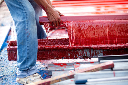 painter is plating iron in the color tray