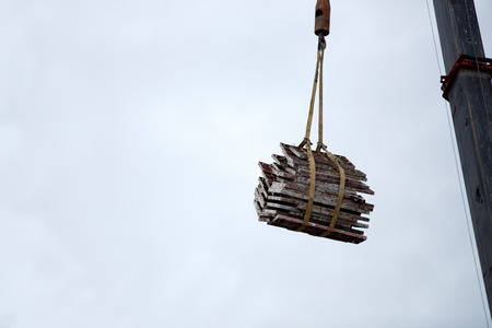 The crane driver is giving the crane for lift steel at construction site 免版税图像 - 110598518