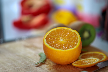 Orange slice on shopping board