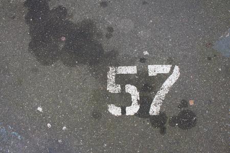 sprayed: Number 57 sprayed painted on a street Stock Photo