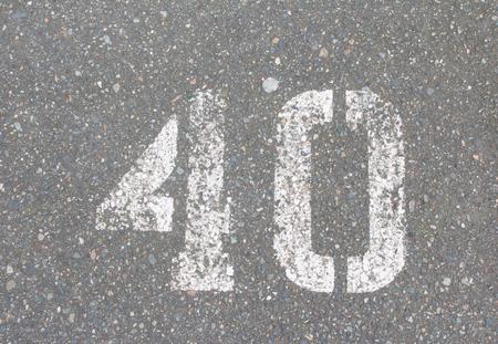 sprayed: Number 40 sprayed paint on a street Stock Photo
