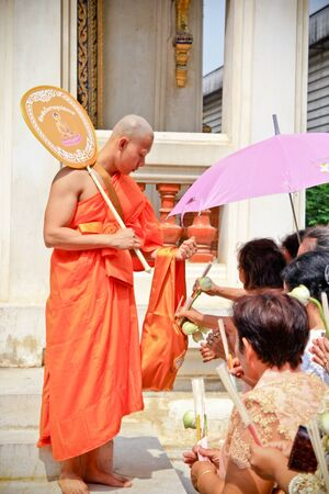 Make a merit to new monk after finish the ceremony Stock Photo - 19010566