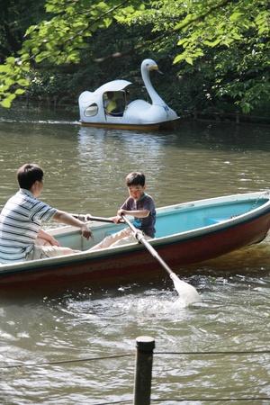 farther: Farther teaching his son to canoe in Inokashira park at Kichijoji Tokyo