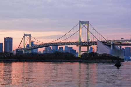 Rainbow bridge with sun light at Odaiba , Japan photo