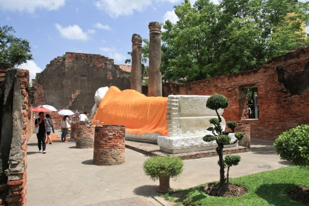 AYUTTHAYA, THAILAND - JUNE 14: Visitor praying the sleeping buddha in the ancient temple on June 14, 2009 in Ayutthaya, Thailand