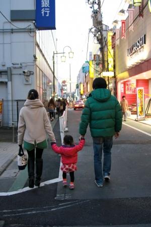 TOKYO,JAPAN - DEC 28: Lovely family walking in the shopping street on Dec 29, 2011 in Jijugaoka, Tokyo, Japan