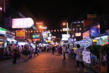 BANGKOK - Dec 24: Unidentified tourists walk along backpacker haven Khao San Road on Dec 24, 2009 in Bangkok, Thailand.