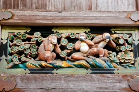 Three wise monkey, detail of the seventeenth century Toshogu shrine in Nikko, Japan