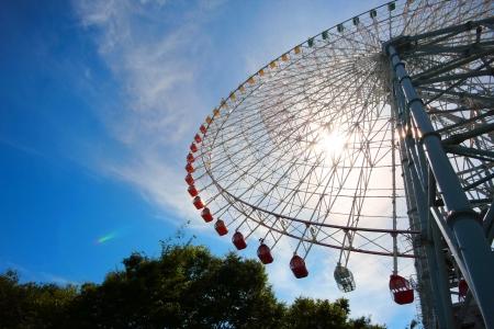 Giant Ferris wheel wit blue sky in Osaka, Japan