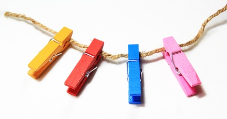colorful clothes pins on a white background photo