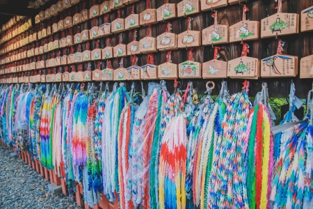hundreds: Hundreds of origami cranes - colorful background at Fushimi Inari shrine in Kyoto prefecture, Japan.