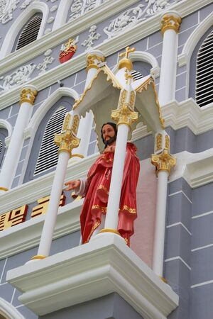 Statue of Jesus on the church in Thailand photo